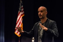 Leon Logothetis, author of The Kindness Diaries, speaks to audience members during a morale event at Scott Air Force Base, Illinois. Oct. 16, 2017. Logothetis he spoke about his journey circumnavigating the globe, relying only on the kindness of strangers to help him. (U.S. Air Force photo by Senior Airman Tristin English)