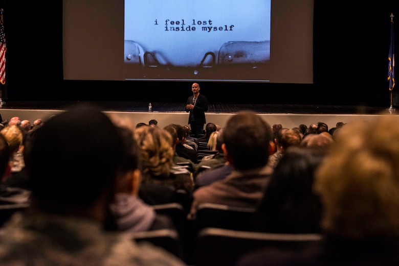 "Leon Logothetis, author of The Kindness Diaries, speaks to members of Air Mobility Command during a morale event at Scott Air Force Base, Oct. 16, 2017. During his presentation, Logothetis reminded the audience that ""everyone matters,"" and kindness is helping others fell less alone. (U.S. Air Force photo by Senior Airman Tristin English)"