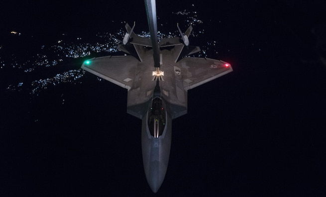 A KC-10 Extender from the 908th Expeditionary Air Refueling Squadron, Al Dhafra Air Base, United Arab Emirates, refuels an F-22 Raptor from the 95th Expeditionary Fighter Squadron in support of a new offensive campaign in Afghanistan Nov. 19, 2017. Afghan National Defense and Security Forces (ANDSF) and United States Forces-Afghanistan (USFOR-A) launched a series of ongoing attacks to hit the Taliban where they are most vulnerable: their revenue streams. Together, Afghan and U.S. forces conducted combined operations to strike drug labs and command-and-control nodes in northern Helmand province. These types of strikes represent the highest level of trust and cooperation between ANDSF and USFOR-A.