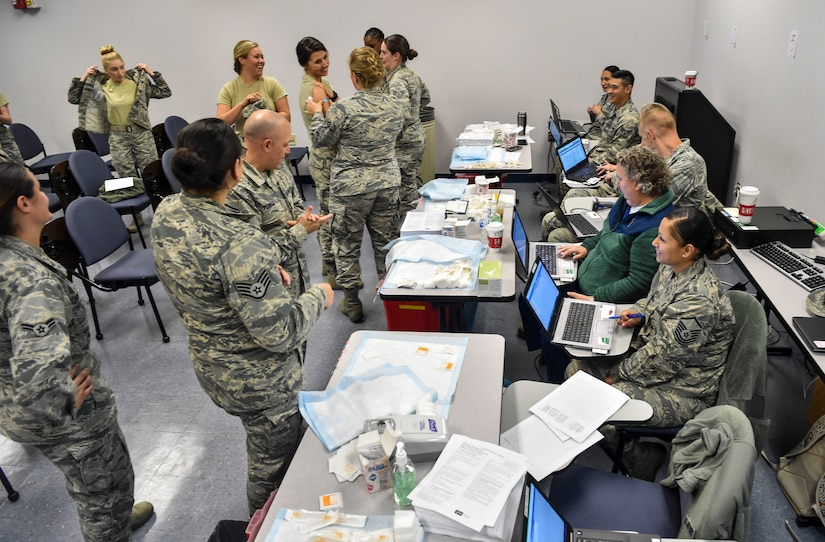 Joint Base Charleston members process through the point of distribution line during a mass-immunization exercise at Joint Base Charleston, S.C., Nov. 15, 2017.