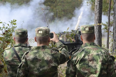 Colombian army leaders observe a live-fire exercise with the M109A6 Paladin 155 mm howitzer during a visit to the South Carolina Army National Guard's 1st Battalion, 178th Field Artillery Regiment, at the McCrady Training Center in Eastover, S.C., Nov. 18, 2017. Colombia and South Carolina are partnered in the State Partnership Program, and the Colombian army is seeking to build up its field artillery program. South Carolina Army National Guard photo by Spc. Chelsea Baker