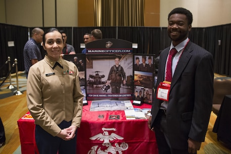 U.S. Marine Corps Maj. Jessica Shearer, Communication Officer, 4th Medical Battalion, 4th Marine Logistics Group, interviews students at the National Society of Black Engineers Symposium in Garden Grove, Calif., November 18, 2017. During the symposium Marines interact with collegiate-level students from across the country whom have shown outstanding qualities in education and leadership. By investing in a diverse and representative officer corps, it will help generate and sustain a future force that has the cultural expertise, language skills, and a variety of philosophies needed to meet the operational requirements of the Marine Corps. (U.S. Marine Corps photo by Lance Cpl. Jesus McCloud/Released)
