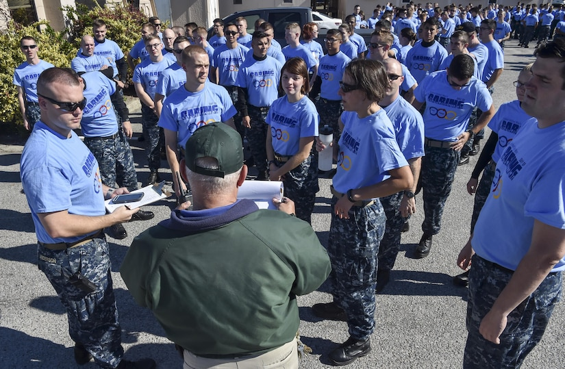 Joint Base Charleston members gather for instructions during the Day of Caring volunteer event at Patriot's Point, Mount Pleasant, S.C., Nov. 17, 2017.