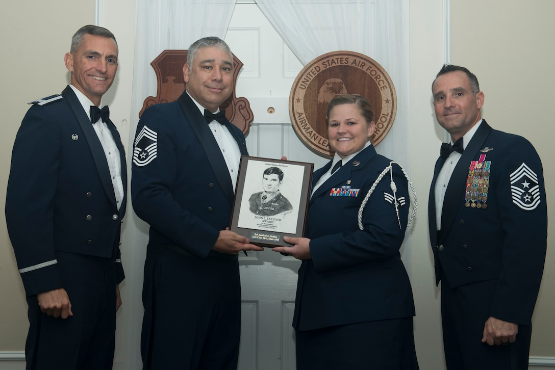 U.S. Air Force Senior Airman Jessika Holden, 20th Medical Operations Squadron, receives the John L. Levitow Award for Class 18-1 of the Senior Master Sgt. David B. Reid Airman Leadership School, at Shaw Air Force Base, South Carolina, Nov. 17, 2017.