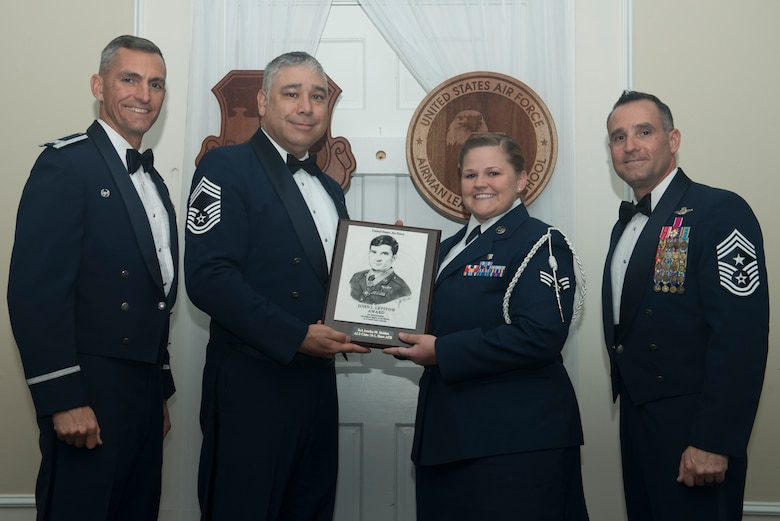 U.S. Air Force Senior Airman Jessika Holden, 20th Medical Operations Squadron, receives the John L. Levitow Award for Class 18-1 of the Senior Master Sgt. David B. Reid Airman Leadership School, at Shaw Air Force Base, South Carolina, Nov. 17, 2017.