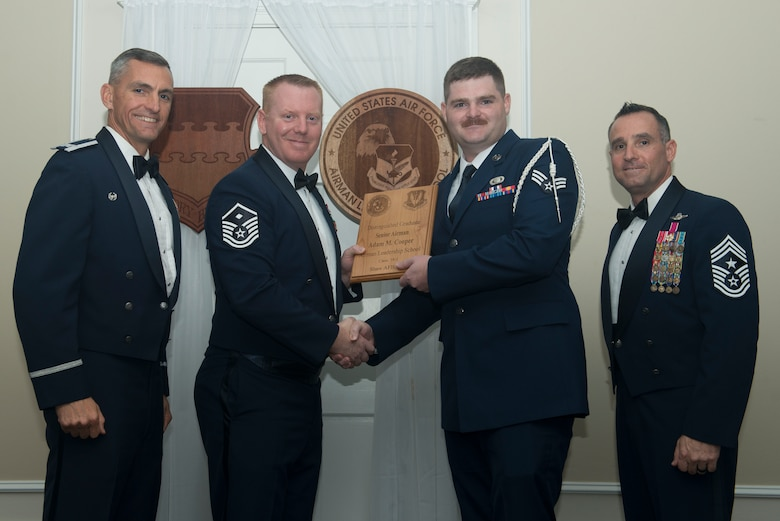U.S. Air Force Senior Airman Adam Cooper, 3rd Intelligence Squadron, receives a distinguished graduate award for Class 18-1 of the Senior Master Sgt. David B. Reid Airman Leadership School, at Shaw Air Force Base, South Carolina, Nov. 17, 2017.