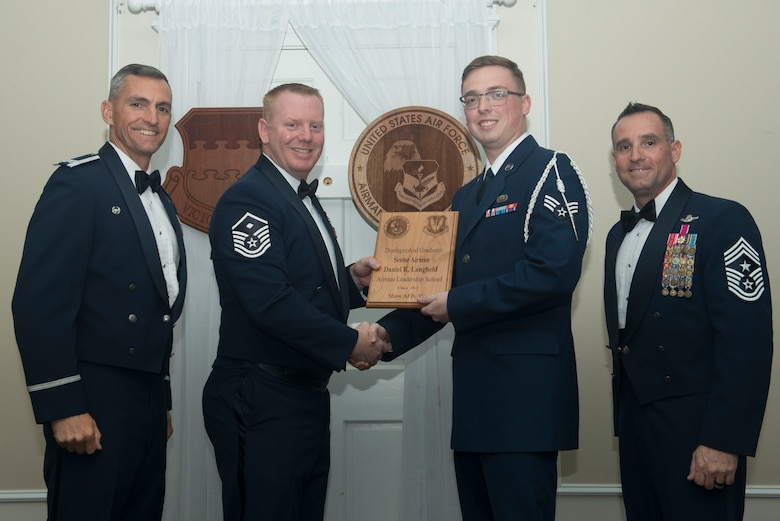U.S. Air Force Senior Airman Daniel Langheld, 3rd Intelligence Squadron, receives a distinguished graduate award for Class 18-1 of the Senior Master Sgt. David B. Reid Airman Leadership School, at Shaw Air Force Base, South Carolina, Nov. 17, 2017.