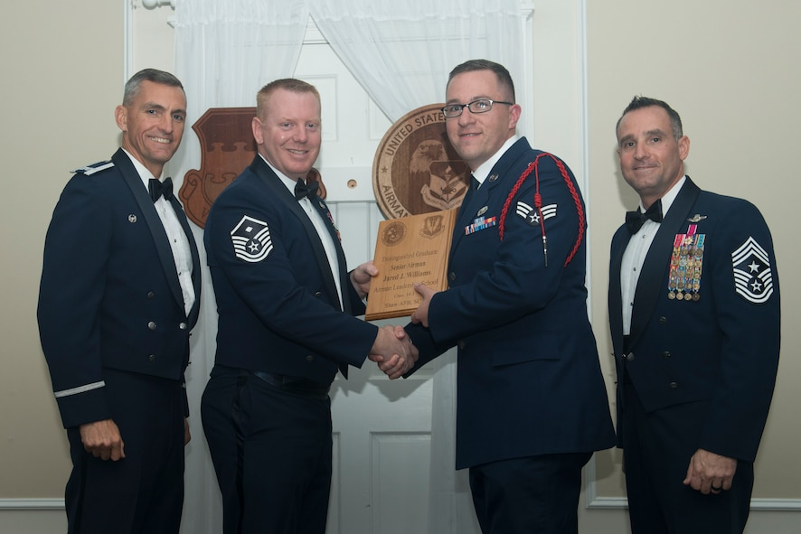 U.S. Air Force Senior Airman Jared Williams, 31st Intelligence Squadron, receives a distinguished graduate award for Class 18-1 of the Senior Master Sgt. David B. Reid Airman Leadership School, at Shaw Air Force Base, South Carolina, Nov. 17, 2017.