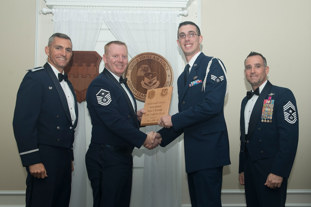 U.S. Air Force Senior Airman Vance Kondon, 3rd Intelligence Squadron, receives a distinguished graduate award for Class 18-1 of the Senior Master Sgt. David B. Reid Airman Leadership School, at Shaw Air Force Base, South Carolina, Nov. 17, 2017.
