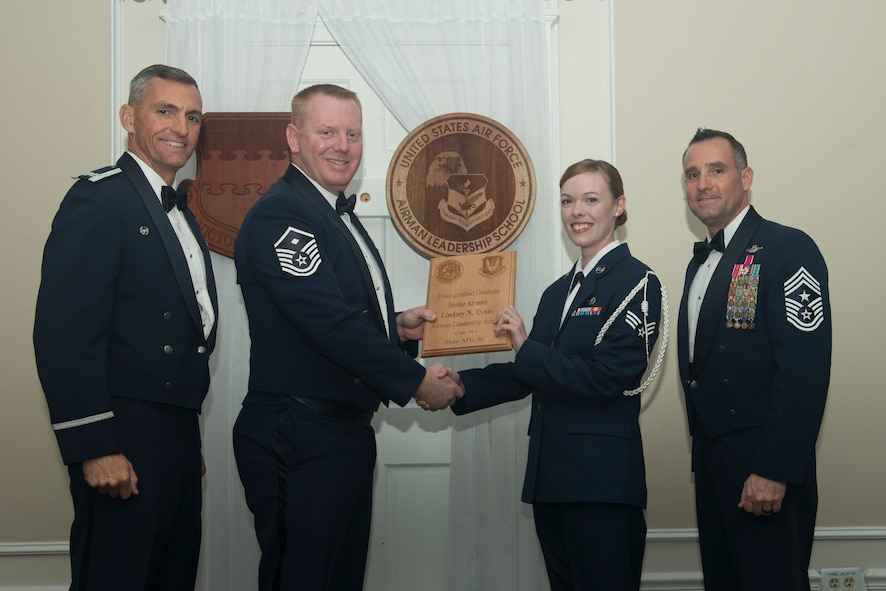 U.S. Air Force Senior Airman Lindsey Evans, 3rd Intelligence Squadron, receives a distinguished graduate award for Class 18-1 of the Senior Master Sgt. David B. Reid Airman Leadership School, at Shaw Air Force Base, South Carolina, Nov. 17, 2017.