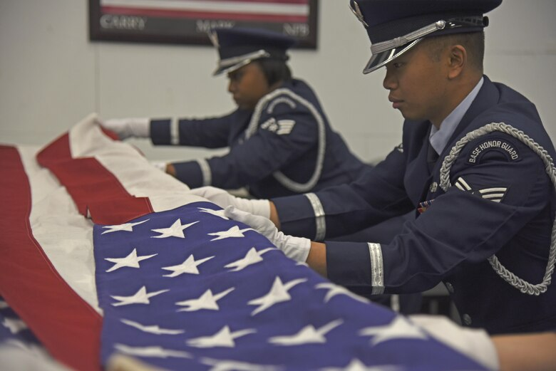 Senior Airman Arcell Salunga, 92nd Force Support Squadron Honor Guardsman, practices military funeral sequences with his flight Nov. 16, 2017, at Fairchild Air Force Base, Washington. Each new rotation begins with an intense 12-day training regimen. These two weeks focus on various color guard, funeral and rifle sequences and movements, starting with the basics and slowly introducing variations. (U.S. Air Force photo/Senior Airman Mackenzie Richardson)
