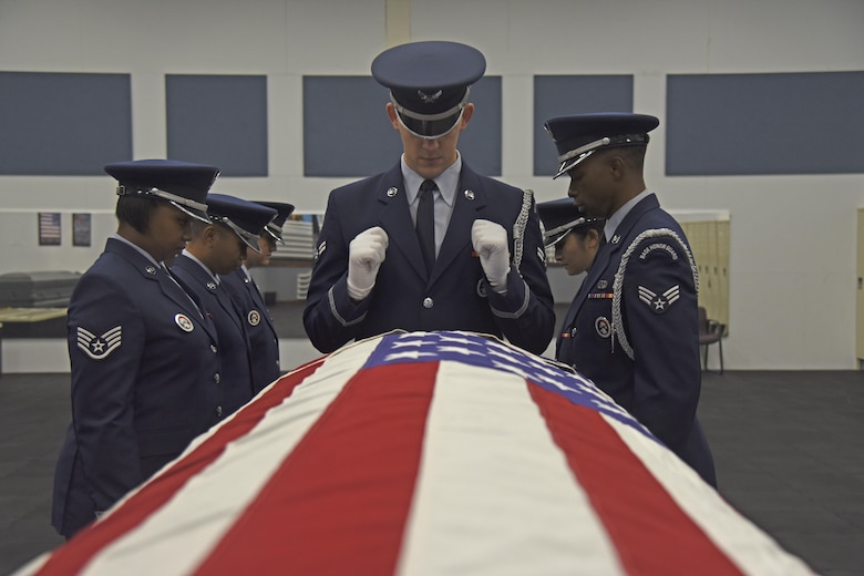 The Fairchild Honor Guard conducts military funeral training Nov. 16, 2017, at Fairchild Air Force Base, Washington. Honor guard's mission is unlike any other, spending upward of 60 hours a week together traveling, training and preparing for ceremonies. The Fairchild Honor Guard covers the entire Pacific Northwest community, displaying their precision and excellence in Washington, Montana, Idaho and Oregon. (U.S. Air Force photo/Senior Airman Mackenzie Richardson)