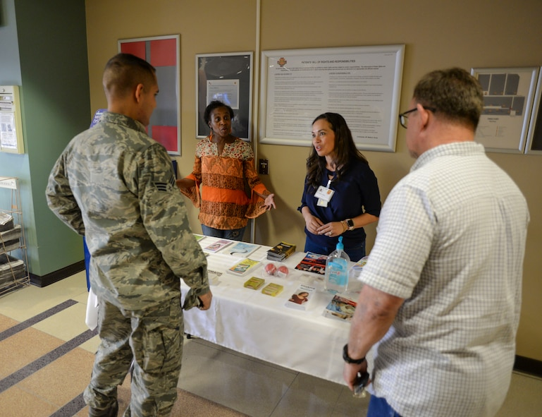 Decora Butler, 56th Medical Group environmental health technician, and Yyolany Caffrey, 56th Medical Group Health Promotions coordinator, answer questions and hand out educational materials about the Great American Smokeout at Luke Air Force Base, Ariz., Nov. 17, 2017. GASO takes place every year on the third Thursday of Novemeber and encourages smokers to quit, or begin to make a plan to quit, using tobacco products. (U.S. Air Force photo/Airman 1st Class Caleb Worpel)