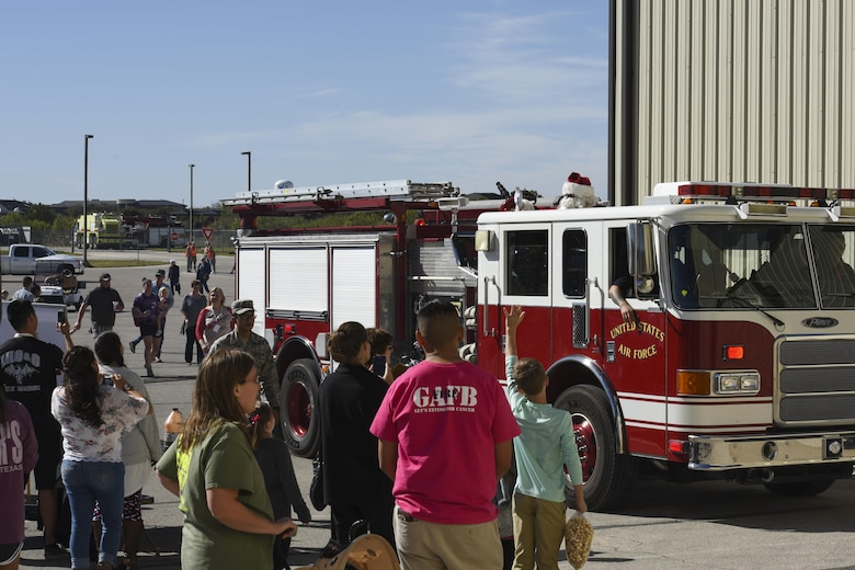Santa Clause arrives to the Santa's Market and Community Appreciation Day at the Louis F. Garland Department of Defense Fire Academy on Goodfellow Air Force Base, Texas, Nov. 18, 2017. Making his grand entrance to the event, Santa swapped his usual red sleigh for one of the Fire Academy's firetrucks. (U.S Air Force photo by Airman 1st Class Zachary Chapman/Released)