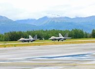 Two F-22 Raptor aircraft prepare to take off during an Air Force Operational Energy mission at Joint Base Elmendorf-Richardson in Anchorage, Alaska, August 13, 2017. The aircraft were part of a demonstration to assess if flying at an increased speed consumes less fuel and while saving precious flight hours.
