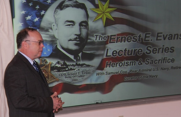 IMAGE: Rear Adm. (Ret.) Samuel Cox, Director of the Naval History and Heritage Command, recently talked about his hero, Medal of Honor recipient Cmdr. Ernest Evans, at Combat Direction Systems Activity Dam Neck. The presentation was in honor of National American Indian Heritage Month. Evans was half-Cherokee and one-quarter Creek Indian and commanded USS Johnston (DD 557) in the Battle off Samar in World War II.