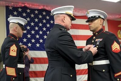 Sgt. Maj. Bryan Fuller (left), Inspector Instructor Sgt. Maj. of Combat Logistics Group 453, and Brig. Gen. Michael Martin (center), Deputy Commanding General of Marine Corps Forces Command, present Marine Corps veteran Sgt. Eubaldo Lovato (right), with the Silver Star award in Montrose, Colorado, Nov. 18, 2017.