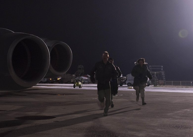 (From left to right) Senior Airman Timothy Diehl, KC-135 Stratotanker boom operator, Maj. Miguel Fernandez, KC-135 pilot, and Senior Airman Megan Myers, 141st Maintenance Group crew chief, respond to an alert call during Exercise Global Thunder 2018 at Fairchild Air Force Base, Washington, Nov. 4, 2017. Global Thunder is an annual U.S. Strategic Command (USSTRATCOM) exercise designed to provide training opportunities to test and validate command, control and operational procedures. The training is based on a notional scenario developed to drive execution of USSTRATCOM and component forces' ability to support the geographic combatant commands, deter adversaries and, if necessary, employ forces as directed by the President of the United States. (U.S. Air Force photo/Senior Airman Ryan Lackey)