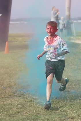 TORII STATION, OKINAWA, Japan – A child finishes the 5th Annual USO Okinawa Color Blast 5K Fun Run Nov. 18 on Torii Station Beach, Okinawa, Japan.