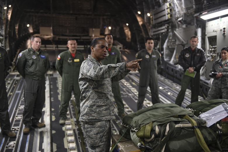 Chief Master Sgt. Shelina Frey, Air Mobility Command command chief, explains to aircrew members of the 15th and 16th Airlift Squadron about how important their feedback is to help the AMC mission while aboard a C-17 Globemaster III on the flightline at Joint Base Charleston, S.C., Nov. 17, 2017.