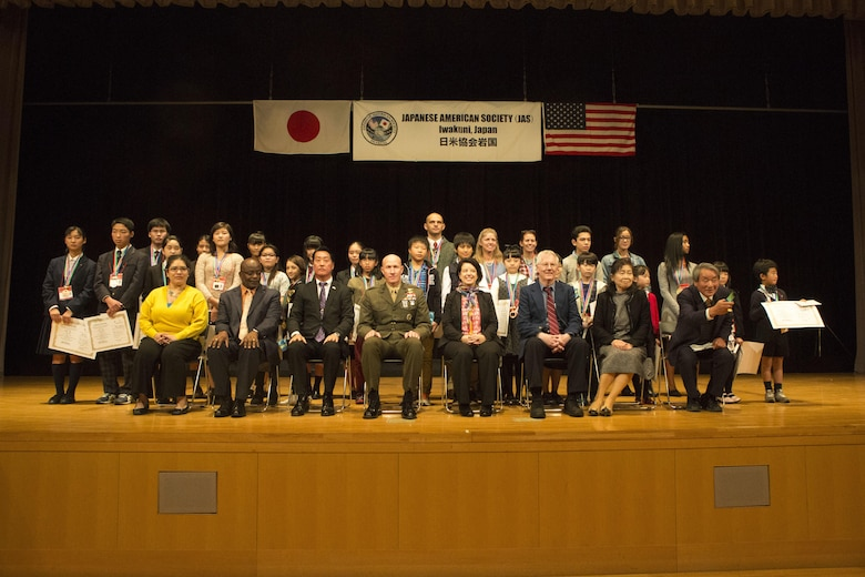 Contestants, judges and distinguished guests pose for a picture during the 56th Annual Japanese and English Speech Contest at Sinfonia Iwakuni Concert Hall in Iwakuni City, Japan, Nov. 19, 2017.  The contest was hosted by the Japanese American Society to help contestants understand and appreciate each other's language and culture, strengthening the Japanese and American friendship.