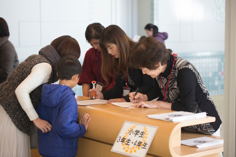 Contestants and visitors register for the 56th Annual Japanese and English Speech Contest at Sinfonia Iwakuni Concert Hall in Iwakuni City, Japan, Nov. 19, 2017.  The contest was hosted by the Japanese American Society to help contestants understand and appreciate each other's language and culture, strengthening the Japanese and American friendship.