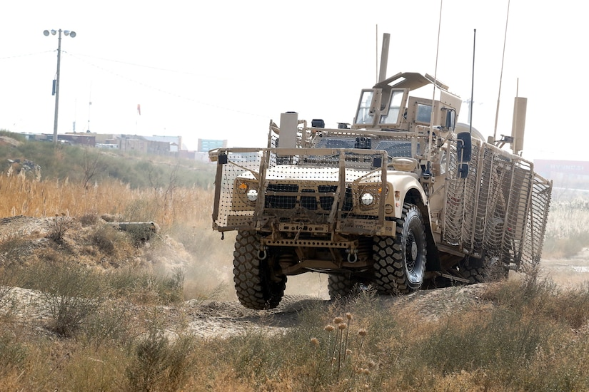 An Oshkosh Defense mine-resistant, ambush-protected all-terrain vehicle bumps across ruts during the off-road portion of the master driver training course at Bagram Airfield, Afghanistan, Nov. 8, 2017. Army photo by Spc. Elizabeth White