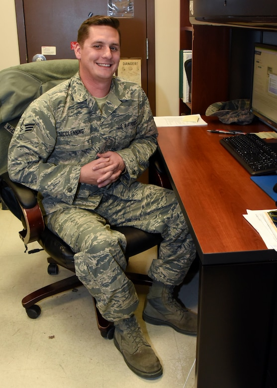 Senior Airman Michael McClenning poses for a photo at his desk Nov. 20, 2017 at Warfield Air National Guard Base, Middle River, Md. McClening spends his days off riding dirt bikes with his friends preparing for the next motocross race they will enter. (U.S. Air National Guard photo by Senior Airman Enjoli Saunders)