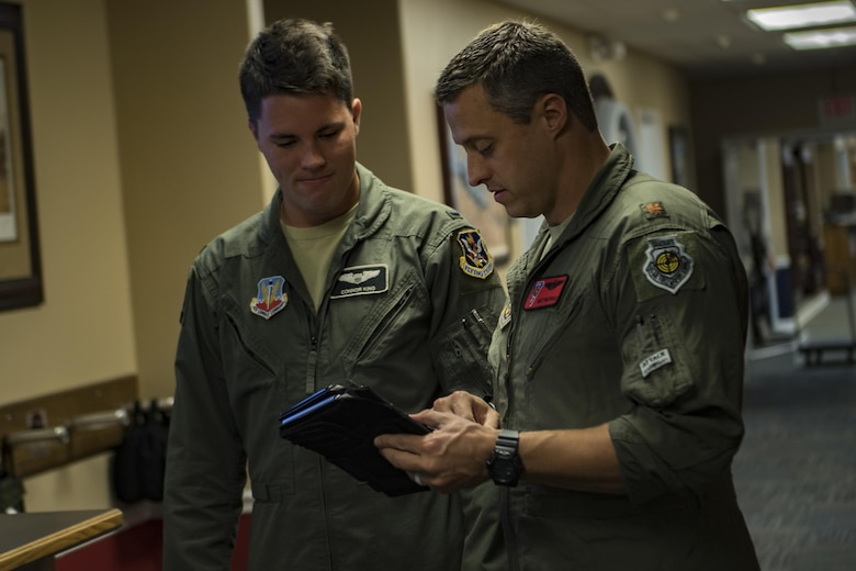U.S. Air Force Reserve Maj. Matt Paetzhold, 76th Fighter Squadron A-10C Thunderbolt II instructor pilot, talks with 1st Lt. Connor King, 75th Fighter Squadron pilot, Sept. 9, 2017, at Moody Air Force Base, Ga. After graduating the Weapons Instructor Course, Paetzhold joined the Airmen who serve as tactical and operational advisors to military leaders at all levels. Due to the relationship between the 75th FS and 76th FS, Paetzhold is slated to deploy as the 75th FSs weapons officer. (U.S. Air Force photo by Senior Airman Daniel Snider)