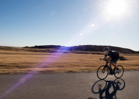 U.S. Air Force Capt. John Lachiewicz, an evaluation pilot with the 54th Air Refueling Squadron, rides his bike on Perimeter Road, Nov. 15, 2017, at Altus Air Force Base, Oklahoma.