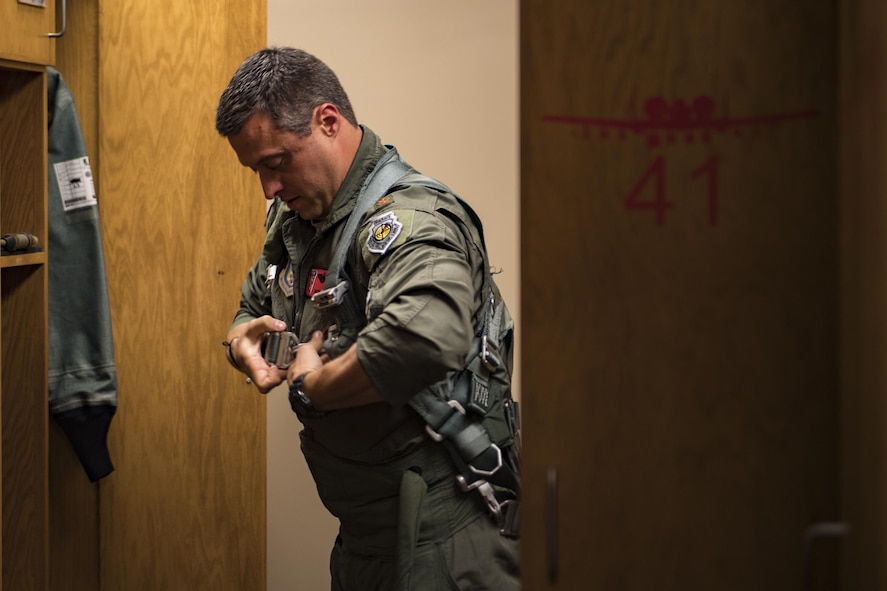 U.S. Air Force Maj. Matt Paetzhold, 76th Fighter Squadron A-10C Thunderbolt II instructor pilot dons equipment before flight, Sept. 9, 2017, at Moody Air Force Base, Ga. After graduating the Weapons Instructor Course, Paetzhold joined the Airmen who serve as tactical and operational advisors to military leaders at all levels. Due to the relationship between the 75th FS and 76th FS, Paetzhold is slated to deploy as the 75th FSs weapons officer. (U.S. Air Force photo by Senior Airman Daniel Snider)