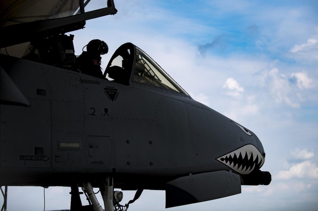 U.S. Air Force Reserve Maj. Matt Paetzhold, 76th Fighter Squadron A-10C Thunderbolt II instructor pilot, performs preflight checks in an A-10C Thunderbolt II, Sept. 9, 2017, at Moody Air Force Base, Ga. After graduating the Weapons Instructor Course, Paetzhold joined the Airmen who serve as tactical and operational advisors to military leaders at all levels. Due to the relationship between the 75th FS and 76th FS, Paetzhold is slated to deploy as the 75th FSs weapons officer. (U.S. Air Force photo by Senior Airman Daniel Snider)