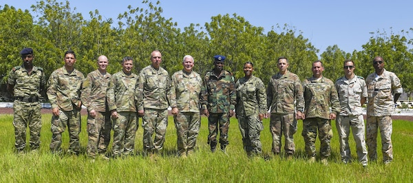 Members of the Combined Joint Task Force - Horn of Africa, Kentucky National Guard, Djibouti Armed Forces (FAD), and French army pose for a group photo during a visit to the FAD military training center at Holhol, Djibouti, Nov. 14, 2017.