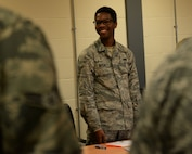 U.S. Air Force Airman Terrance Hardin, 100th Maintenance Squadron aircraft structural maintenance journeyman laughs during a name game ice breaker before the training exercises at RAF Mildenhall, England, Oct. 24, 2017. Members from the 100th Maintenance Squadron participated in the Four Lenses training, hosted by the Equal Opportunity office. The training focuses on learning how to work together despite personality differences. (U.S. Air Force photo by Airman 1st Class Alexandria Lee)