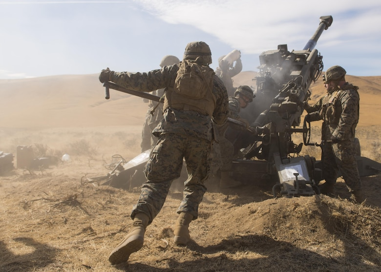 Marines of P Battery 5/14 use a ramming rod to push a 100-pound, high explosive projectile into the barrel of a M777A2 howitzer weapon system during a live-fire training exercise at the Yakima Training Center, Washington, Oct 14, 2017. In use by several armies by the mid-seventeenth century, the howitzer continues to be a staple of siege warfare to this day, allowing long-range, indirect fire on targets. (U.S. Air Force photo/Senior Airman Ryan Lackey)