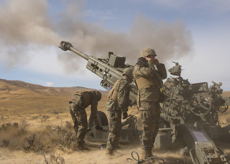 Marines of P Battery 5/14 fire a high explosive projectile downrange from a M777A2 howitzer weapon system during a live-fire training exercise at the Yakima Training Center, Washington, Oct 14, 2017. The muzzle brake located at the end of a M777A2 howitzer barrel, takes the energy of the extra propellant gases when fired and redirects it backwards into the ground, slowing the recoil and preventing the weapon from bouncing. (U.S. Air Force photo/Senior Airman Ryan Lackey)