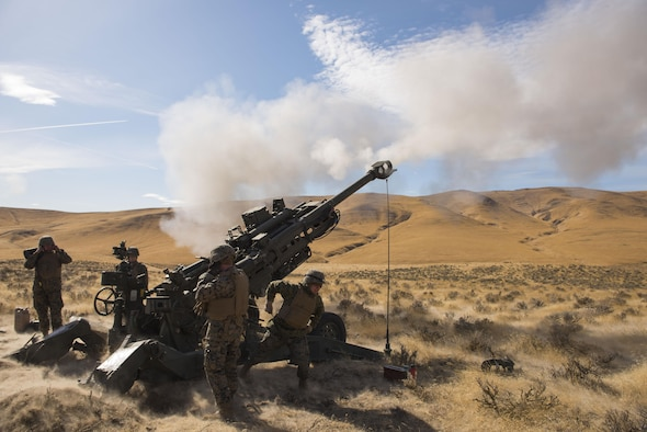 Marines of P Battery 5/14 fire a high explosive projectile downrange from a M777A2 howitzer weapon system during a live-fire training exercise at the Yakima Training Center, Washington, Oct 14, 2017. USMC artillery units mission is to provide long range fire support to infantry ground forces down-range in a deployed environment. (U.S. Air Force photo/Senior Airman Ryan Lackey)