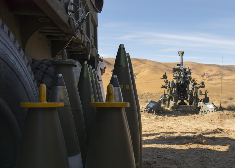 155 mm projectiles for a M777A2 howitzer sit beside their ammo truck during a live-fire U.S. Marine Corps training exercise at the Yakima Training Center, Washington, Oct 14, 2017. The M777 howitzer is a towed, lightweight artillery piece that succeeded the M198 howitzer in the USMC and U.S. Army in 2005. (U.S. Air Force photo/Senior Airman Ryan Lackey)
