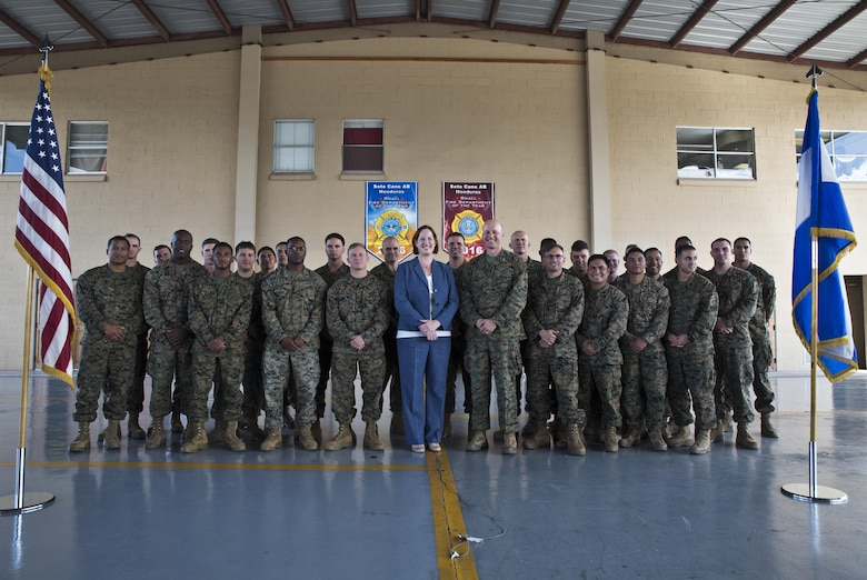 U.S. Marine Col. Michael V. Samarov, the commander of Special Purpose Marine Air-Ground Task Force - Southern Command, and Heide B. Fulton, the chargé d' affaires with the U.S. Embassy in Honduras, pose for a photo with Marines during a closing ceremony at Soto Cano Air Base, Honduras, Nov. 8, 2017. The unit held a closing ceremony to wrap up their six-month deployment to Central America and to thank interagency and international partners for their support. The Marines and sailors of SPMAGTF-SC have completed a successful deployment in Central America and are scheduled to return to the United States in mid-November 2017.