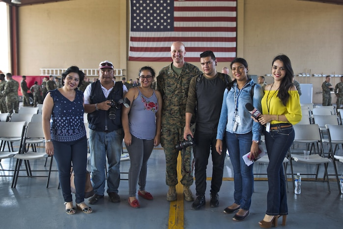 U.S. Marine Col. Michael V. Samarov, the commander of Special Purpose Marine Air-Ground Task Force - Southern Command, poses for a photo with Honduran press members after a closing ceremony at Soto Cano Air Base, Honduras, Nov. 8, 2017. The unit held a closing ceremony to wrap up their six-month deployment to Central America and to thank interagency and international partners for their support. The Marines and sailors of SPMAGTF-SC have completed a successful deployment in Central America and are scheduled to return to the United States in mid-November 2017.