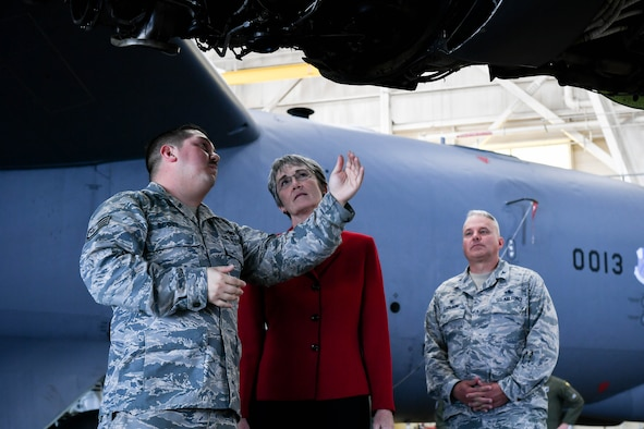 2nd Maintenance Squadron Airmen demonstrates a B-52H Stratofortress engine to, Secretary of the Air Force Heather Wilson during her tour of Barksdale Air Force Base, La., Nov. 14, 2017. As part of the tour Wilson spoke about a budget that supports the continuation and modernization of the nuclear triad. With the B-52H Stratofortress being estimated to be in service until 2050, The bomber is expected to receive upgraded engines with over 30 percent fuel reduction and 95 percent reduction in maintenance needs  (U.S. Air Force photo by Senior Airman Mozer O. Da Cunha)
