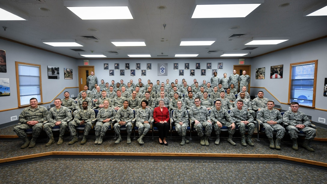 Secretary of the Air force Heather Wilson, poses for a photo with Airmen Leadership School students during her tour of Barksdale Air Force Base, La., Nov. 14, 2017. Wilson spoke about force priorities, passing on her message to future supervisors training to lead innovation. (U.S. Air Force photo by Senior Airman Mozer O. Da Cunha)