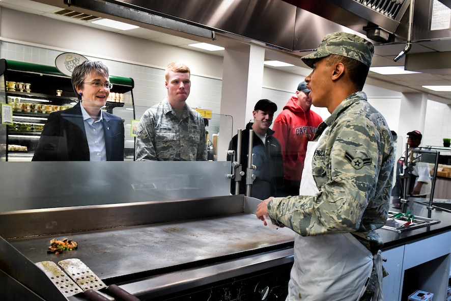 Secretary of the Air Force Heather Wilson speaks to a 2nd Force Support Airmen before meeting with junior Airmen during her tour at Barksdale Air Force Base, La., Nov. 14, 2017. Wilson Spoke with Airmen about the importance of readiness, modernization and innovation to remain the greatest Air Force in the world. (U.S. Air Force photo by Senior Airman Mozer O. Da Cunha)