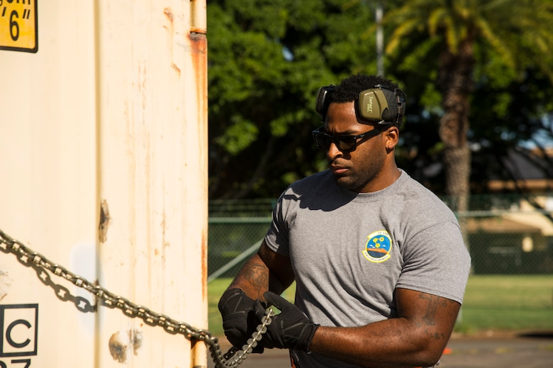 Staff Sgt. Byron Patrick, 735th Air Mobility Squadron reserve coordinator, secures a shipping container for the pallet build-up competition during the Hickam Port Dawg Challenge, at Joint Base Pearl Harbor-Hickam, Hawaii, Nov. 17, 2017. The aerial port community hosts a Port Dawg Challenge every year to promote professionalism, and demonstrate air and space expeditionary force capabilities. (U.S. Air Force photo by Tech. Sgt. Heather Redman)