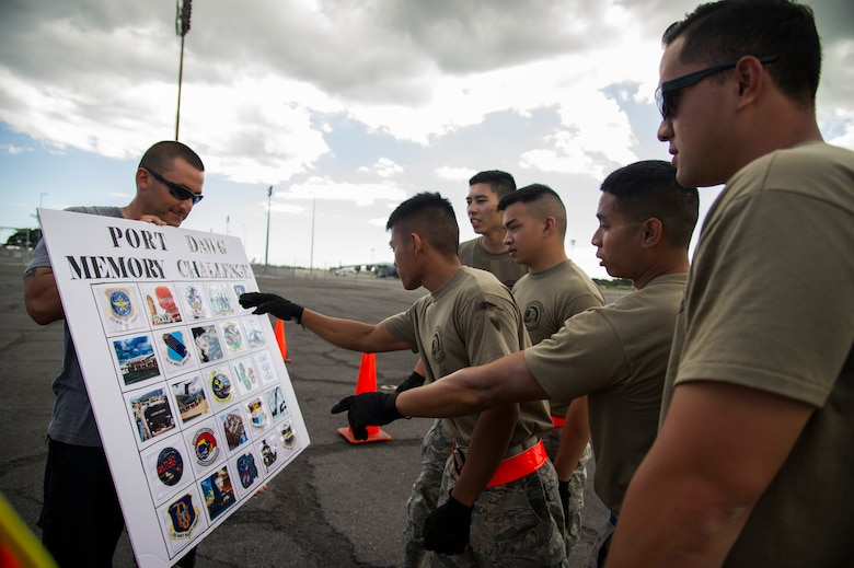 Members of the 48th Aerial Port Squadron review a memory board during the combat fitness challenge portion of the Hickam Port Dawg Challenge, at Joint Base Pearl Harbor-Hickam, Hawaii, Nov. 17, 2017. The aerial port community hosts a Port Dawg Challenge every year to promote professionalism, and demonstrate air and space expeditionary force capabilities. (U.S. Air Force photo by Tech. Sgt. Heather Redman)