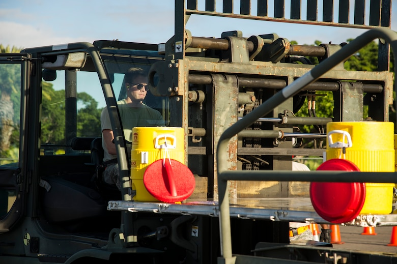 Senior Airman Ron Motz, 735th Air Mobility Squadron air freight journeyman, completes the second leg of the forklift obstacle during the Hickam Port Dawg Challenge, at Joint Base Pearl Harbor-Hickam, Hawaii, Nov. 17, 2017. The aerial port community hosts a Port Dawg Challenge every year to promote professionalism, and demonstrate air and space expeditionary force capabilities. (U.S. Air Force photo by Tech. Sgt. Heather Redman)