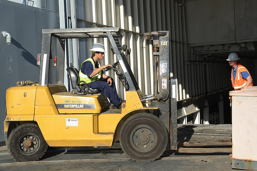 Iker Urruchi, Military Sealift Command's USNS Brittin boatswain's mate, operates a forklift on the vessel at Port of Ponce, Puerto Rico, Nov. 3, 2017.