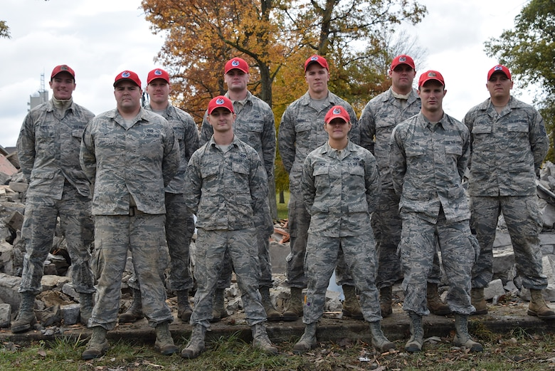 WRIGHT-PATTERSON AIR FORCE BASE, Ohio – 200th RED HORSE Detachment 1 members (back row, l to r) Senior Airman Zachary Purtee, 2nd Lt. Brett Baver, Airman 1st Class Kyle Panico, Senior Airman Jarrod Harvey, Airman 1st Class Matthew Brown, Master Sgt. Zachary Gwirtz, (front row, l to r) Senior Airman Joey Lewis, Airman 1st Class Chase Gardull, Tech. Sgt. Brittany French, Staff Sgt. Adam Juhlke. (U.S. Air Force photo/Katie Scott)
