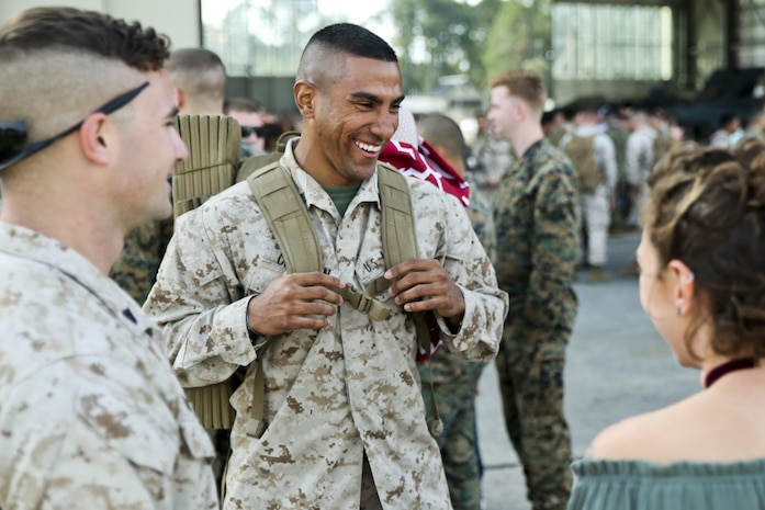 A Marine chats with fellow Marines after from a seven month deployment, Nov. 21, aboard Marine Corps Air Station Beaufort. Marine All-Weather Fighter Attack Squadron 224 left for the deployment to support combat operations in the Central Command area of operations, May 8. The Marine is with VMFA(AW)-224.