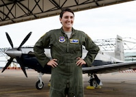 Capt. Karen Miller, 37th Flying Training Squadron instructor pilot, stands in front of a T-6A Texan II Nov. 15, 2017, at Columbus Air Force Base, Mississippi. Miller was one of eight Airmen selected for the Inter-American Squadron Officer School at Joint Base San Antonio-Lackland, Texas. (U.S. Air Force photo by Airman 1st Class Beaux Hebert)